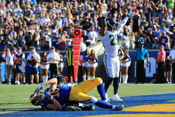 LOS ANGELES, CA - OCTOBER 08:   Earl Thomas #29 of the Seattle Seahawks reacts to a broken pass play to  Cooper Kupp #18 of the Los Angeles Rams during the second half of a game  at Los Angeles Memorial Coliseum on October 8, 2017 in Los Angeles, California.  (Photo by Sean M. Haffey/Getty Images)