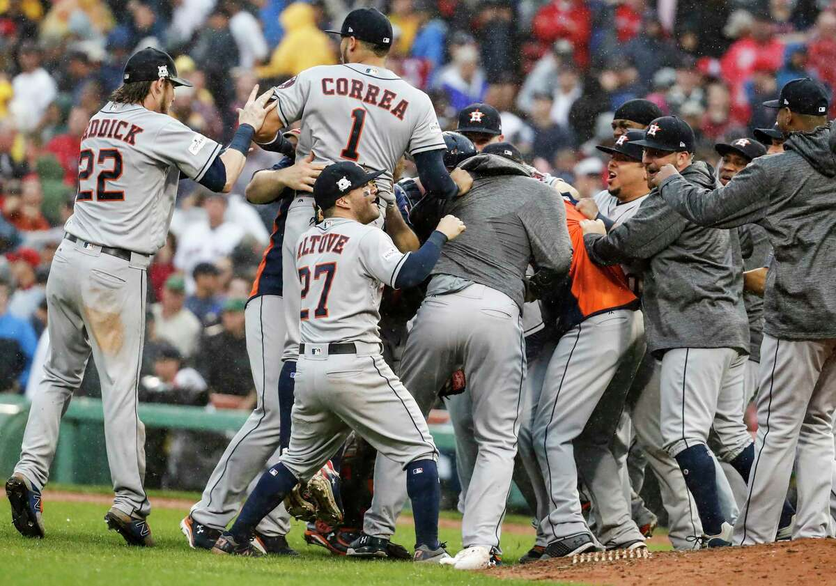 The Houston Astros celebrate the Astros 5-4 win over the Boston Red Sox in Game of the ALDS at Fenway Park on Monday, Oct. 9, 2017, in Boston. The Astros won the series 3-1.
