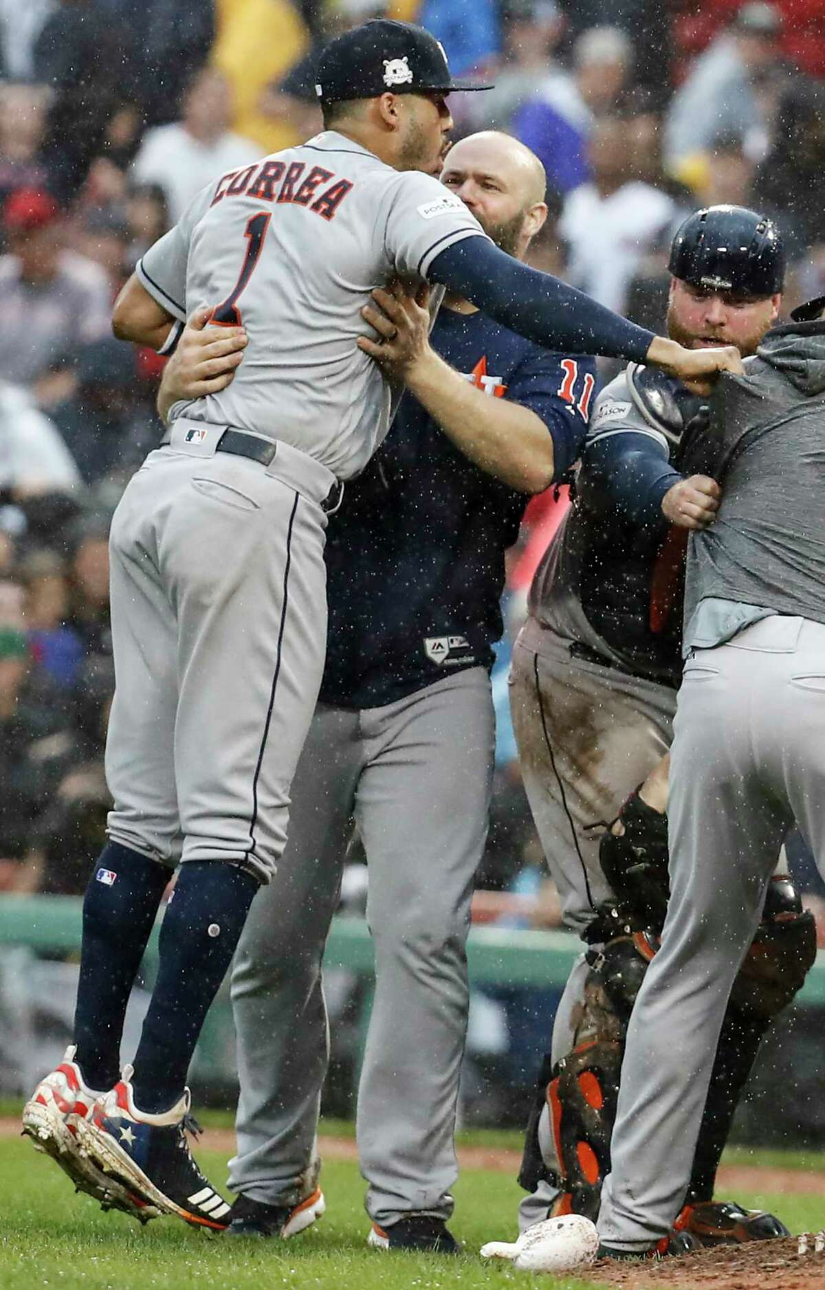 Houston Astros shortstop Carlos Correa (1), designated hitter Evan Gattis (11) and catcher Brian McCann (16) celebrate the Astros 5-4 win over the Boston Red Sox in Game of the ALDS at Fenway Park on Monday, Oct. 9, 2017, in Boston. The Astros won the series 3-1.