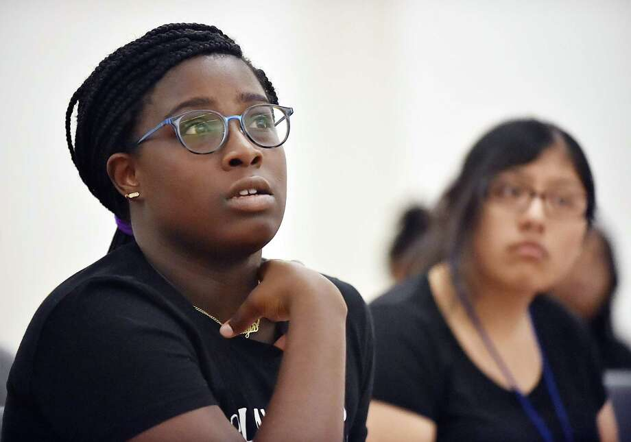 Makayla Dawkins, a junior at James Hillhouse High School, answers a question about immigration during her sociology class in the Middle College program at Gateway Community College in New Haven. Photo: Catherine Avalone / Hearst Connecticut Media / New Haven Register