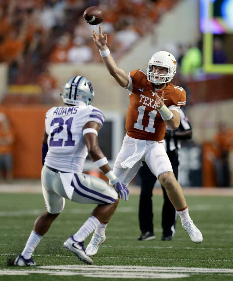 Texas quarterback Sam Ehlinger passes over Kansas State defensive back Kendall Adams during UT's double overtime victory Oct. 7, 2017 in Austin, Texas. Photo: Eric Gay /AP Photo