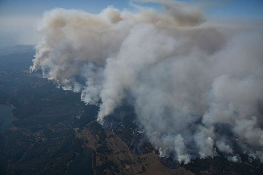 Fires burns in the hills north east of Napa Calif. on Monday, Oct. 9, 2017. Photo: Michael Short / The San Francisco Chronicle Photo: Michael Short / The San Francisco Chronicle
