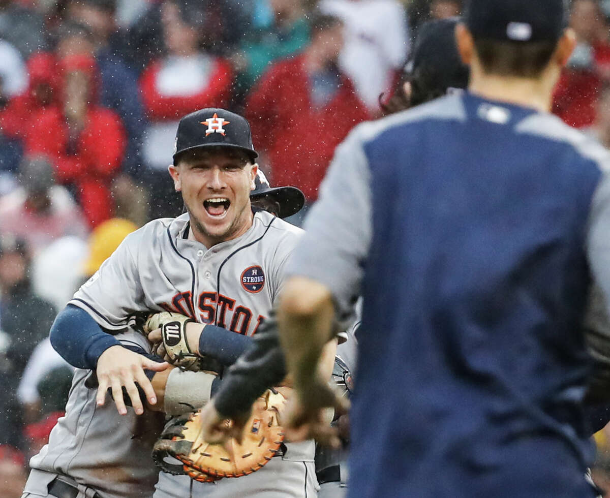 Houston Astros third baseman Alex Bregman, left, celebrates the Astros 5-4 win over the Boston Red Sox in Game of the ALDS at Fenway Park on Monday, Oct. 9, 2017, in Boston. The Astros won the series 3-1.