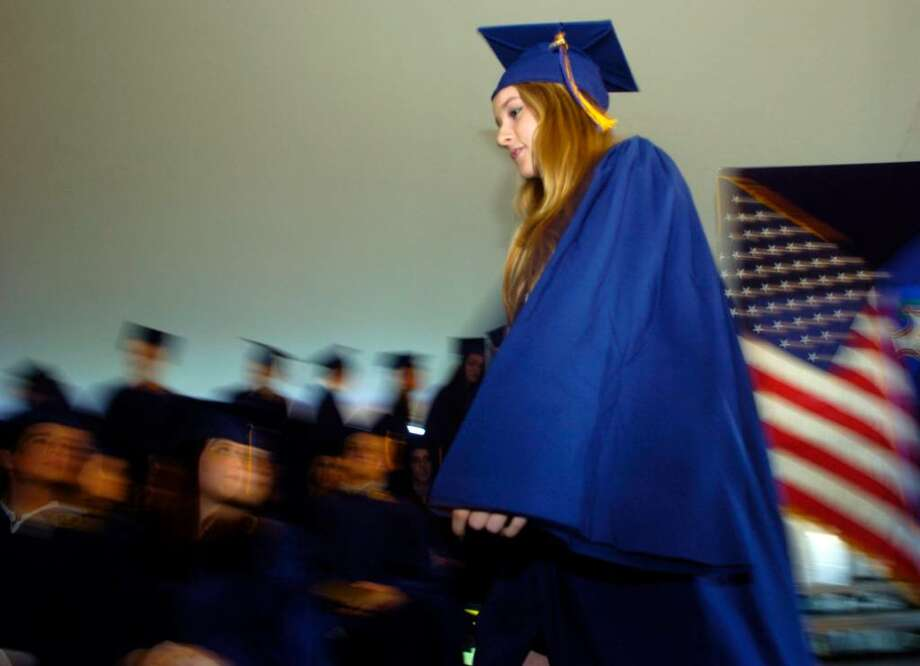 Catherine Roberts walks across the stage to accept her diploma during the Weston High School graduation ceremony at the school on Thursday, June 24, 2010. Photo: Lindsay Niegelberg / Connecticut Post