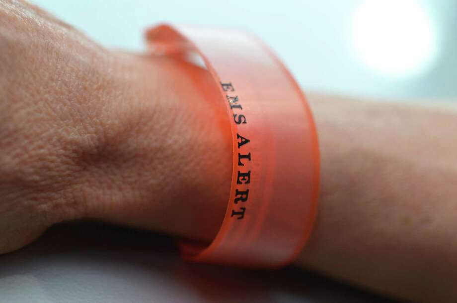 A wristband that is issued by Western Connecticut Health Network for people who have end of life and Do Not Resuscitate or DNR wishes in place. Photo: Alex Von Kleydorff / Hearst Connecticut Media / Norwalk Hour