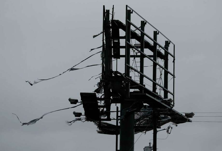 A billboard structure is seen ripped to shreds on Aug. 26 in the aftermath of Hurricane Harvey along Texas 35 going toward Rockpor. (Kin Man Hui/San Antonio Express-News) Photo: Kin Man Hui, Staff / ©2017 San Antonio Express-News