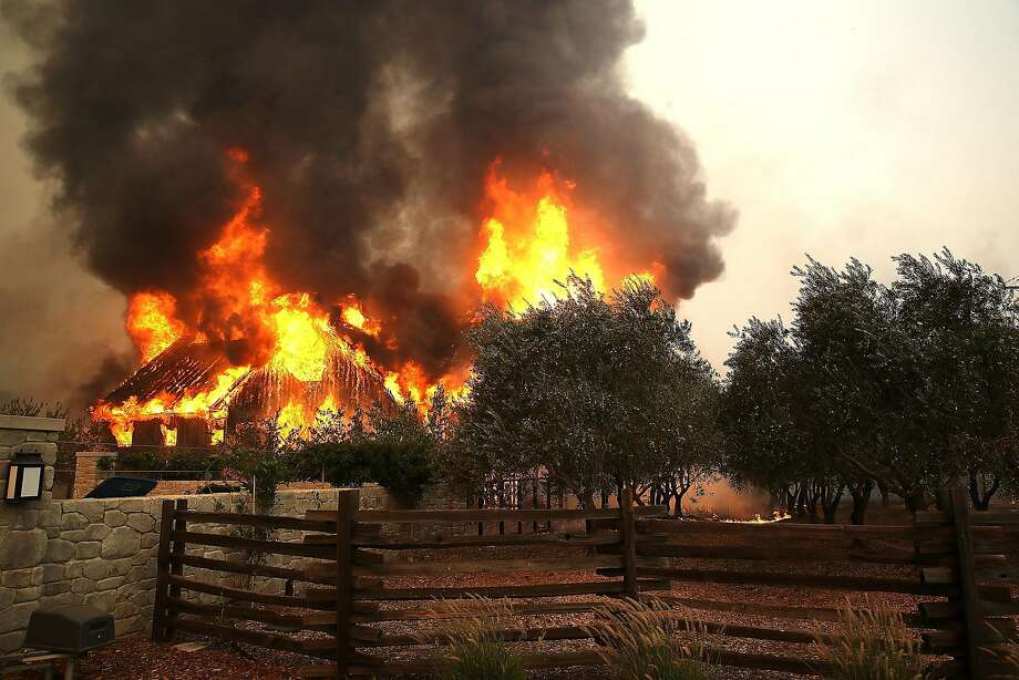 Fire consumes a barn as a wildfire moves through Glen Ellen, Calif., on Oct. 9, 2017. Photo: Justin Sullivan, Getty Images