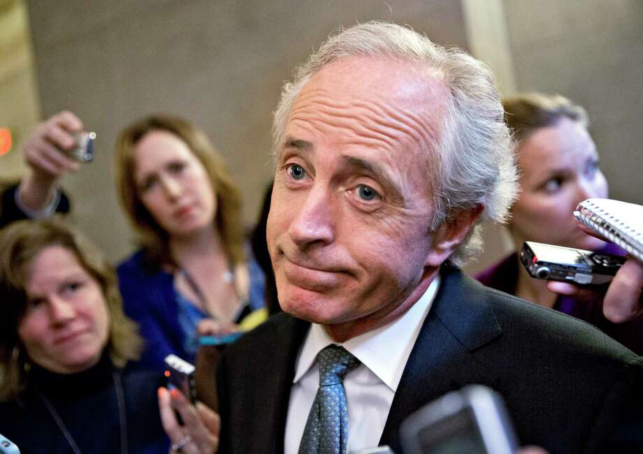 FILE - In this Oct. 11, 2013 file photo, Sen. Bob Corker, R-Tenn., speaks to reporters on Capitol Hill in Washington. Corker is hardly the only Republican lambasting President Donald Trump and raising dark concerns about harm the president might cause the U.S. and the world. He's just the only one who's sounding off in public. (AP Photo/J. Scott Applewhite, File) Photo: J. Scott Applewhite, STF / The Associated Press