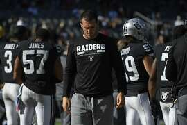 Injured Oakland Raiders quarterback Derek Carr paces the bench while playing the Baltimore Ravens in the fourth quarter at the Coliseum in Oakland, Calif., on Sunday, Oct. 8, 2017. (Jose Carlos Fajardo/Bay Area News Group/TNS)