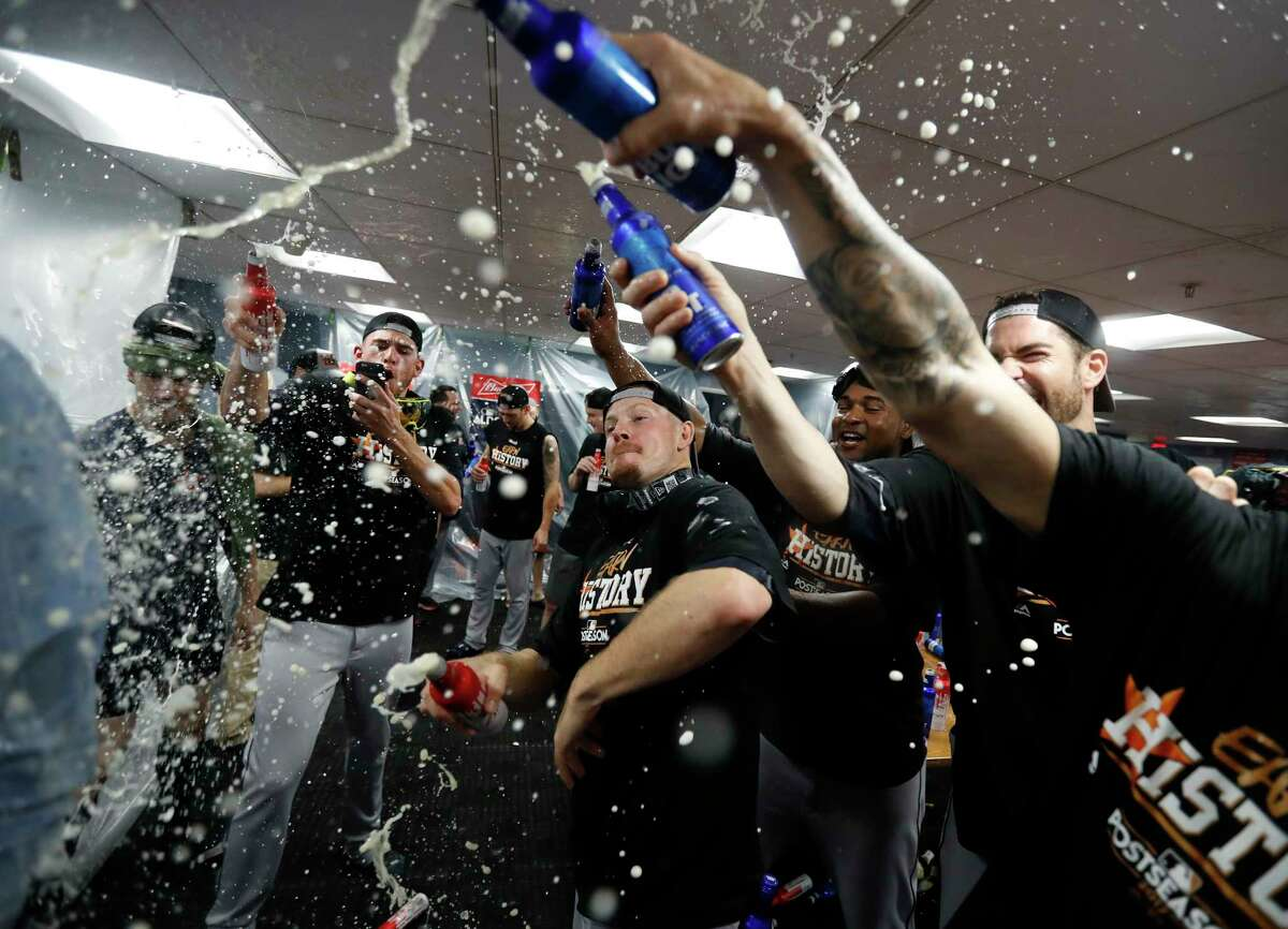 Houston Astros pitchers throw beer on a member of the Astros digital team as they celebrated in the clubhouse after the Astros beat Boston Red Sox 5-4 in the ALDS Game 4 at Fenway Park, Monday, Oct. 9, 2017, in Boston .