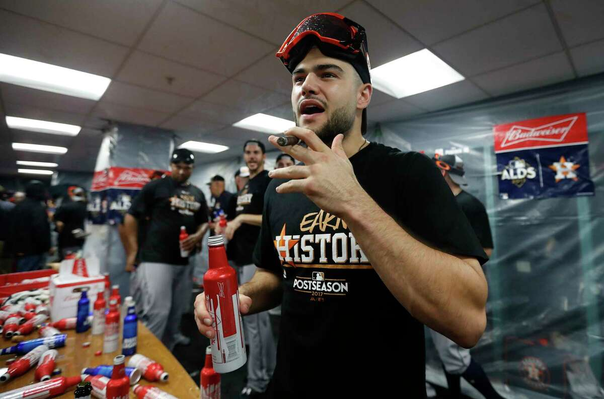 Houston Astros pitcher Lance McCullers Jr. lights up a cigar during celebrations in the clubhouse after the Astros beat Boston Red Sox 5-4 in the ALDS Game 4 at Fenway Park, Monday, Oct. 9, 2017, in Boston .