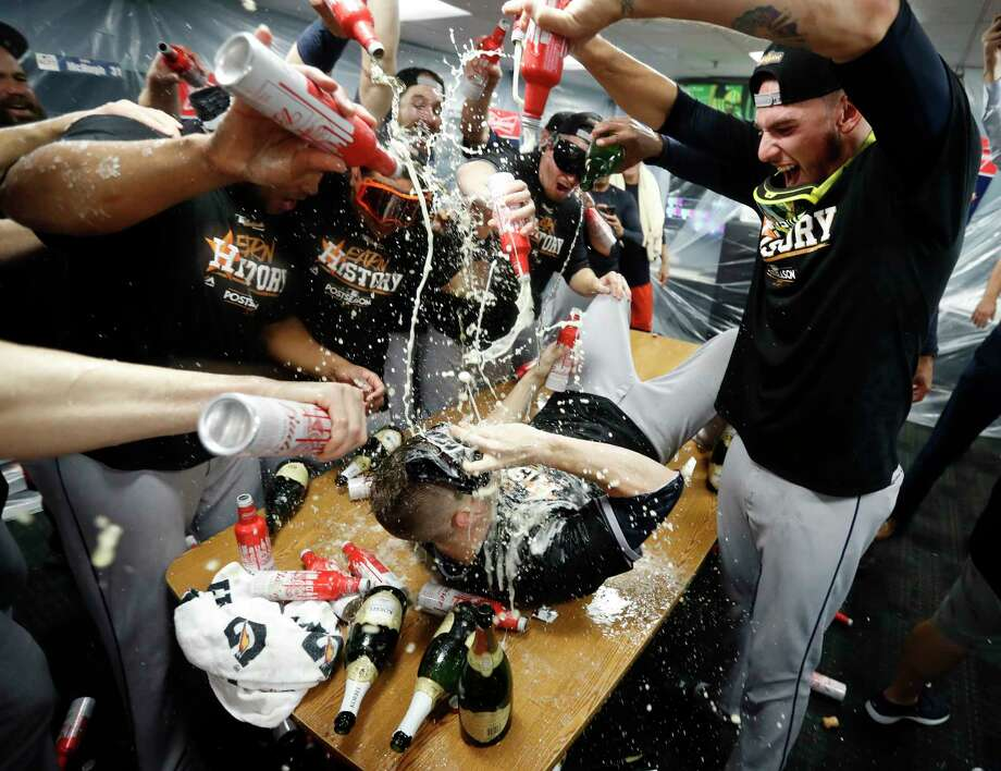 PHOTOS: Astros' epic celebration after winning the ALDSHouston Astros Ken Giles lies on the table as he gets doused in beer by other pitchers including Joe Musgrove after the Astros beat Boston Red Sox 5-4 in the ALDS Game 4 at Fenway Park, Monday, Oct. 9, 2017, in Boston.Browse through the photos above for a look at the Astros' locker room celebration after Monday's win to eliminate the Boston Red Sox. Photo: Karen Warren / @ 2017 Houston Chronicle