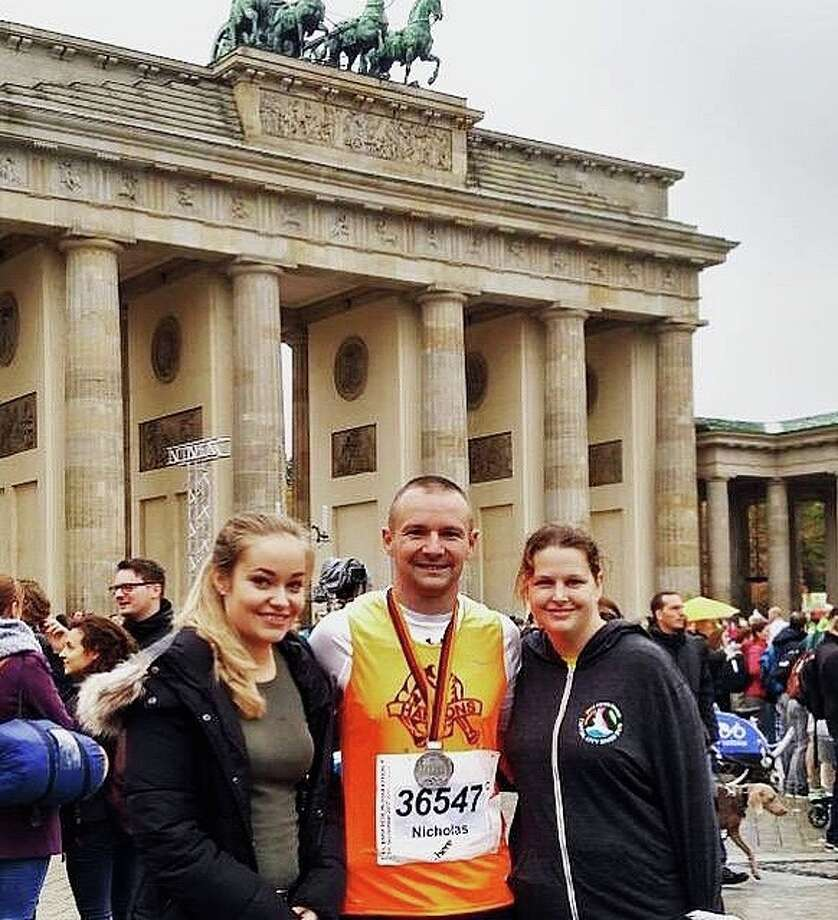 Bad Axe's Nick Rochefort poses with his wife Abigail (right) and former exchange student Kim Neukamm (left) after recently finishing Berlin Marathon. (Courtesy Photo)