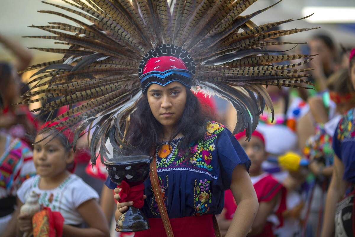 LOS ANGELES, CA - OCTOBER 08: A student of Anahuacalmecac International University Preparatory of North America school for indigenous students holds incense during an event celebrating Indigenous Peoples Day in the Hollywood area on October 8, 2017 of Los Angeles, Californiaa. The event is a celebration of the Los Angeles County's decision to replace Columbus Day with Indigenous Peoples Day. Both the city and the county of Los Angeles have approved the replacement on each second Monday in October, starting no later than 2019. October 12 will be Italian-American Heritage Day. (Photo by David McNew/Getty Images)