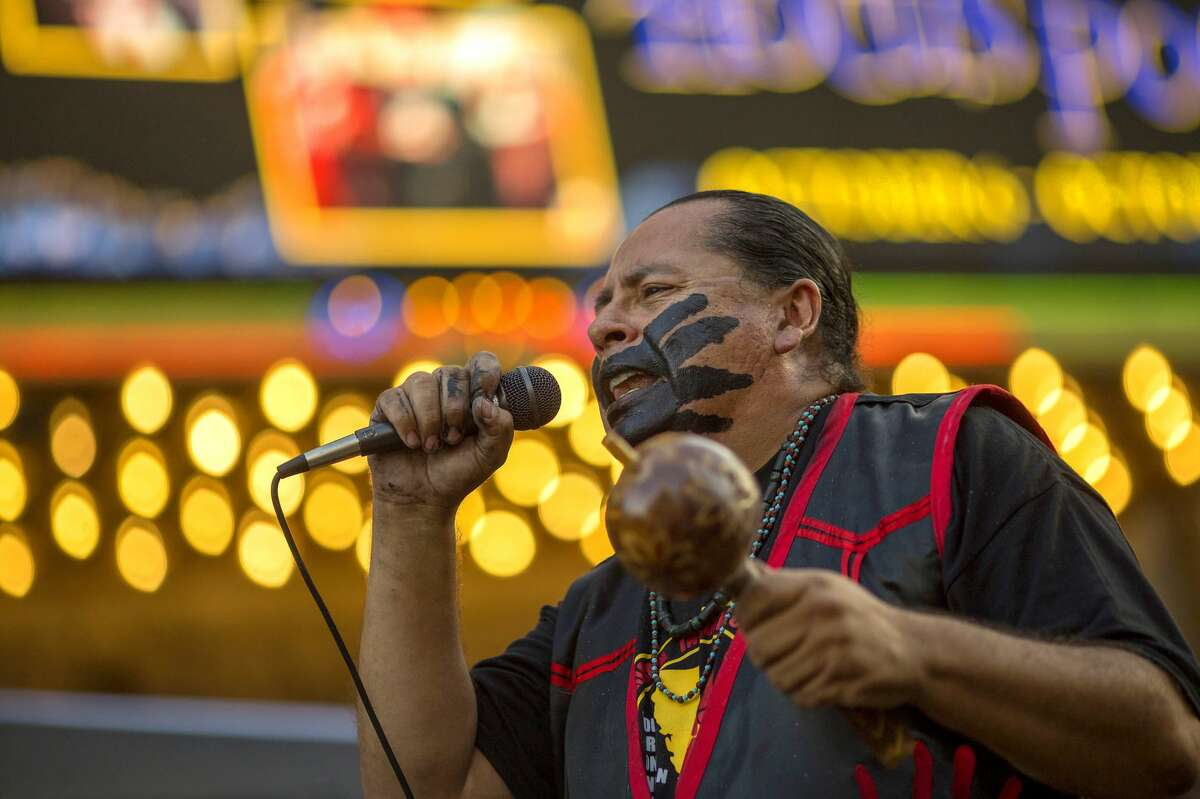 LOS ANGELES, CA - OCTOBER 08: Yaotl Mazahua performs with the indigenous band Aztlan Underground on Hollywood Boulevard during an event celebrating Indigenous Peoples Day in the Hollywood area on October 8, 2017 of Los Angeles, Californiaa. The event is a celebration of the Los Angeles County's decision to replace Columbus Day with Indigenous Peoples Day. Both the city and the county of Los Angeles have approved the replacement on each second Monday in October, starting no later than 2019. October 12 will be Italian-American Heritage Day. (Photo by David McNew/Getty Images)