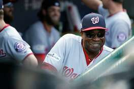 Washington Nationals manager Dusty Baker smiles from the dugout before Game 3 of the National League Division Series baseball game against the Chicago Cubs Monday, Oct. 9, 2017, in Chicago.