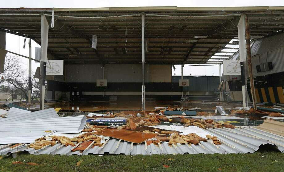 The Rockport-Fulton High School gym shows extensive damage in the aftermath of Hurricane Harvey in Rockport in this Aug. 26 photo. State officials estimate it will cost Texas taxpayers $1.64 billion over the next two years to help schools ravaged by Hurricane Harvey rebuild and avoid financial loses, according to recently released documents. Photo: Kin Man Hui /San Antonio Express-News / ©2017 San Antonio Express-News