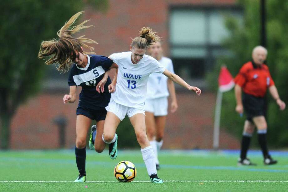 Darien High School junior Ellen Harnisch, center, jockeys with Staples High School sophomore Ava Simunovic for possession of the ball during the varsity girls soccer game at Darien High School in Darien, Conn. on Monday, Oct. 9, 2017. Photo: Michael Cummo / Hearst Connecticut Media / Stamford Advocate