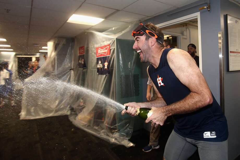 Astros ace Justin Verlander celebrates with teammates after beating the Red Sox 5-4 in Game 4 to win their AL Division Series. Photo: Elsa, Getty Images