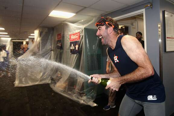 BOSTON, MA - OCTOBER 09:  Justin Verlander #35 of the Houston Astros celebrates with teammates in the clubhouse after defeating the Boston Red Sox 5-4 in game four of the American League Division Series at Fenway Park on October 9, 2017 in Boston, Massachusetts. The Astros advance to the American League Championship Series.  (Photo by Elsa/Getty Images)