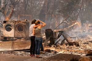 Steph Gediman, (left) comforts Brandi Burns in front of Burns' destroyed at the scene of the Tubbs Fire in Santa Rosa, Ca., on Monday October 9, 2017. Massive wildfires ripped through Napa and Sonoma counties early Monday, destroying hundreds of homes and businesses on Monday October 9, 2017