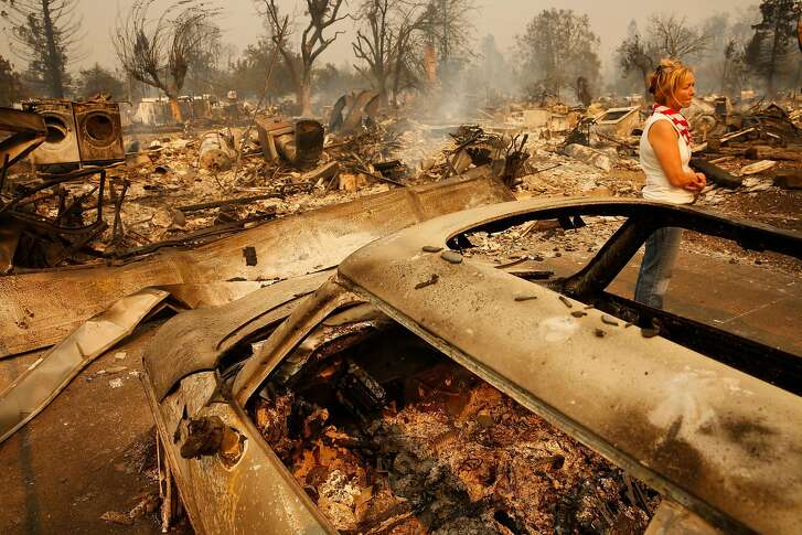 Terrie Burns, in front of her destroyed home,  where dozens of homes burned at the scene of the Tubbs Fire in Santa Rosa, Ca., on Monday October 9, 2017. Massive wildfires ripped through Napa and Sonoma counties early Monday, destroying hundreds of homes and businesses on Monday October 9, 2017
