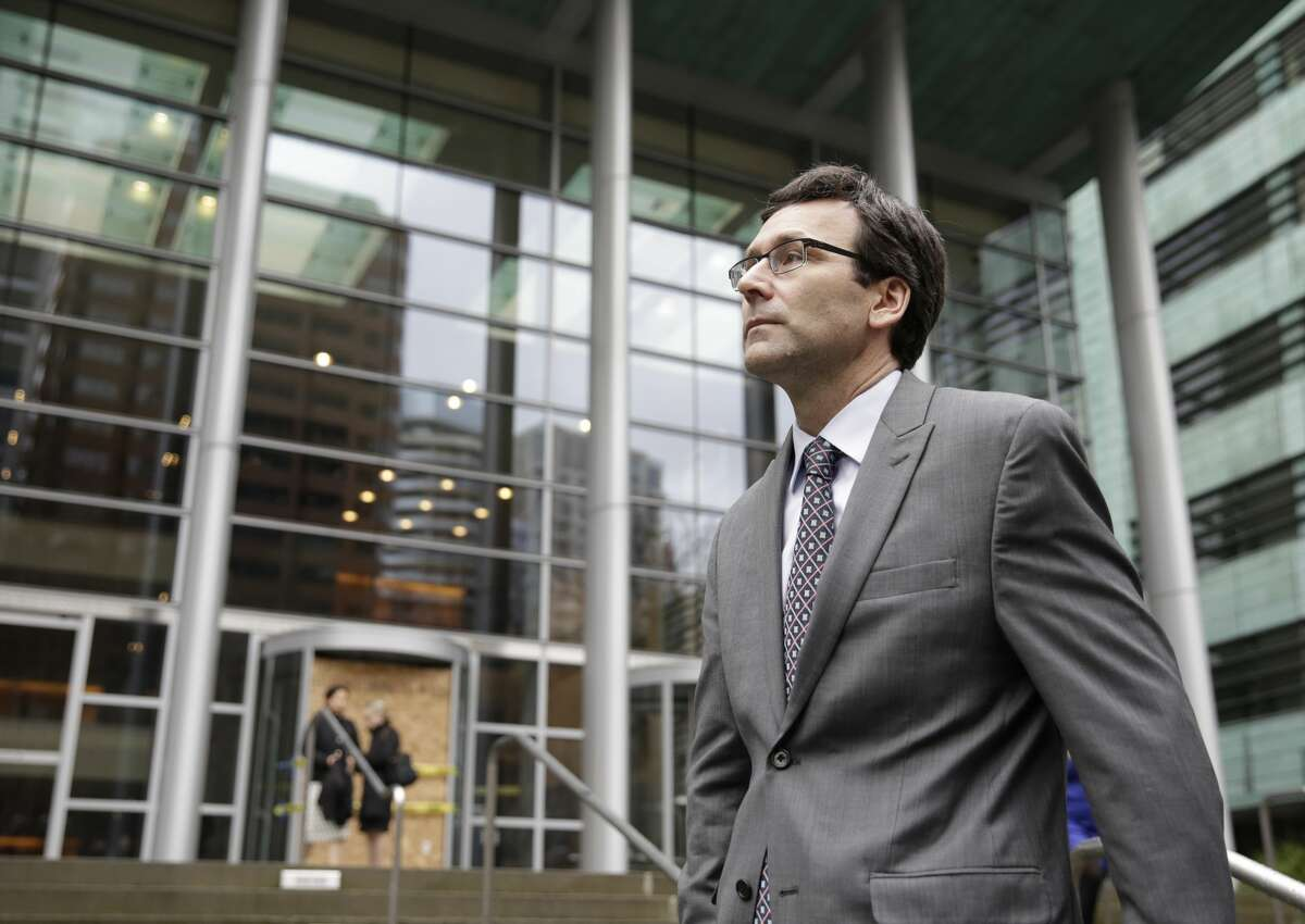 Washington State Attorney General Bob Ferguson waits to addresses the media following a hearing about US President Donald Trump's travel ban at the US District Court in Seattle, Washington on March 15, 2017. A federal court in Hawaii halted Donald Trump's controversial revised executive order closing US borders to refugees and nationals from six Muslim-majority countries, dealing the president a humiliating fresh defeat. / AFP PHOTO / Jason Redmond (Photo credit should read JASON REDMOND/AFP/Getty Images)