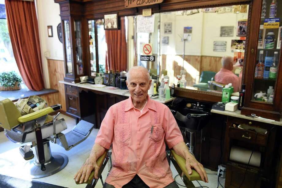 Barber Frank Potenza, 90, proprietor of Lansing Barber Shop on Third Street, sits for a photo on Friday morning, Sept. 29, 2017, iat his shop in the Lansingburgh neighborhood of Troy, N.Y. (Will Waldron/Times Union) Photo: Will Waldron / 20041712A