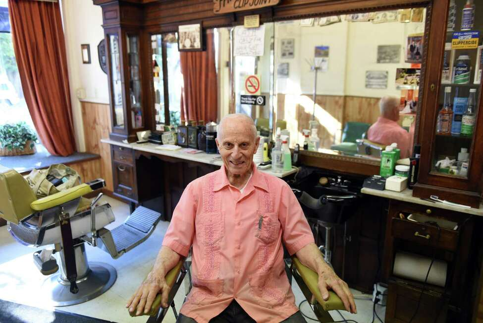 Barber Frank Potenza, 90, proprietor of Lansing Barber Shop on Third Street, sits for a photo on Friday morning, Sept. 29, 2017, iat his shop in the Lansingburgh neighborhood of Troy, N.Y. (Will Waldron/Times Union)