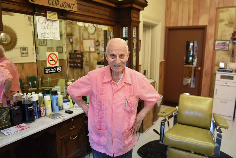 Barber Frank Potenza, 90, proprietor of Lansing Barber Shop on Third Street, stands for a photo on Friday morning, Sept. 29, 2017, iat his shop in the Lansingburgh neighborhood of Troy, N.Y. (Will Waldron/Times Union)