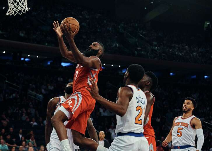 Houston Rockets' Eric Gordon (10) drives to the basket against New York Knicks' Damyean Dotson (21) during the first half of a preseason NBA basketball game at Madison Square Garden in New York, Monday, Oct. 9, 2017. (AP Photo/Andres Kudacki)