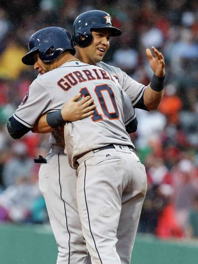 The Astros' Yuli Gurriel shows an affection for insurance runs after pinch hitter Carlos Beltran's ninth-inning RBI double, which made it 5-3 and proved crucial. Photo: Karen Warren, Staff / © 2017 Houston Chronicle