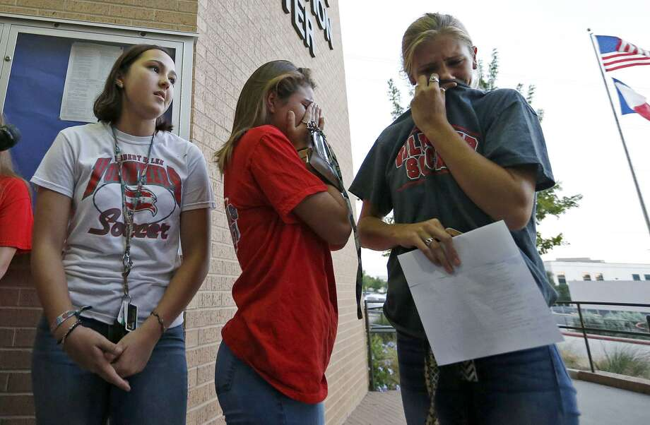 Lee High School seniors Selah Evans (from left), Savannah Vathy and Kendall Kloza answer questions from the media after the North East Independent School District Board voted to change the name of Lee High School to Legacy of Educational Excellence High School.Click through the slideshow to view more reactions to the L.E.E. High School name change. Photo: Edward A. Ornelas /San Antonio Express-News / © 2017 San Antonio Express-News