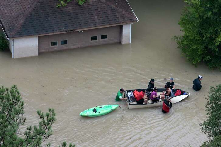 Flood victims are evacuated by boat from their neighborhood near the Addicks Reservoir as floodwaters rise from Tropical Storm Harvey on Tuesday, Aug. 29, 2017, in Houston. ( Brett Coomer / Houston Chronicle )