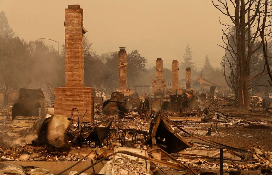 Chimneys line the streets after the fire in Santa Rosa, Ca., on Monday October 9, 2017. Massive wildfires ripped through Napa and Sonoma counties early Monday, destroying hundreds of homes and businesses on Monday October 9, 2017 Photo: Michael Macor, The Chronicle