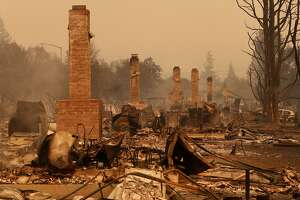 Chimneys line the streets after the fire in Santa Rosa, Ca., on Monday October 9, 2017. Massive wildfires ripped through Napa and Sonoma counties early Monday, destroying hundreds of homes and businesses on Monday October 9, 2017