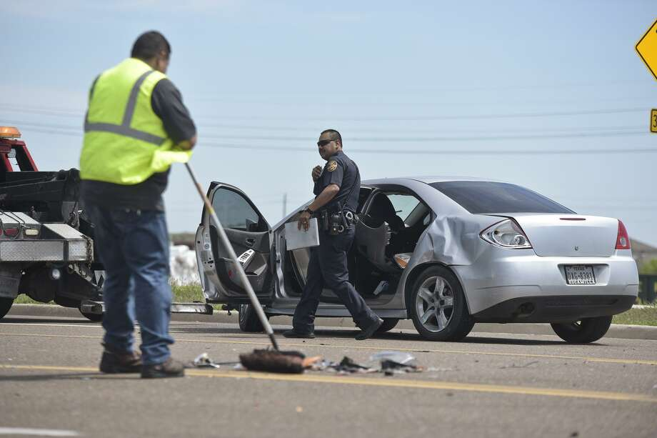 A Laredo Police officer finishes assessing the scene of an accident, Monday afternoon, that occured at the intersection of Shiloh Drive and Kirby Drive after two vehicles were involved in a collision. Photo: Danny Zaragoza, Staff Photographer / LAREDO MORNING TIMES