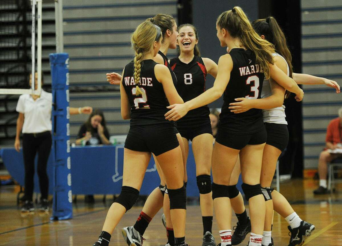 Warde teammates celebrate winning a point during Monday's game against Bunnell in Stratford.