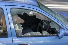 """""""A jagged black hole with cracked and crazed glass reveals the workings of a thief in the night, during the morning after. One more car crime on the streets of London.More smashed windows / broken glass:"""" burglar"""