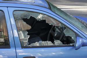 """A jagged black hole with cracked and crazed glass reveals the workings of a thief in the night, during the morning after. One more car crime on the streets of London.More smashed windows / broken glass:""  burglar"