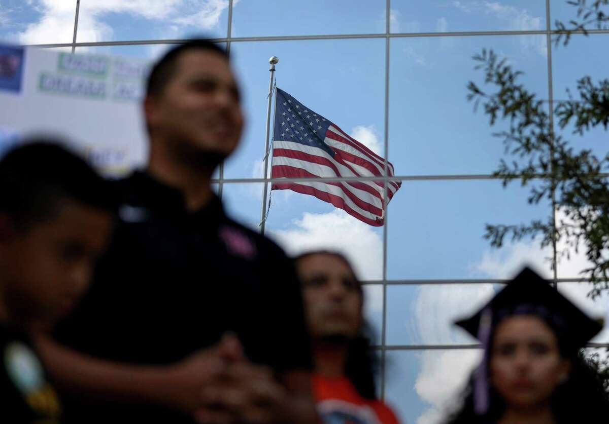 People speak during a press conference calling for action to help DACA recipients, at the Mickey Leland Federal Building, Monday, Oct. 9, 2017, in Houston.