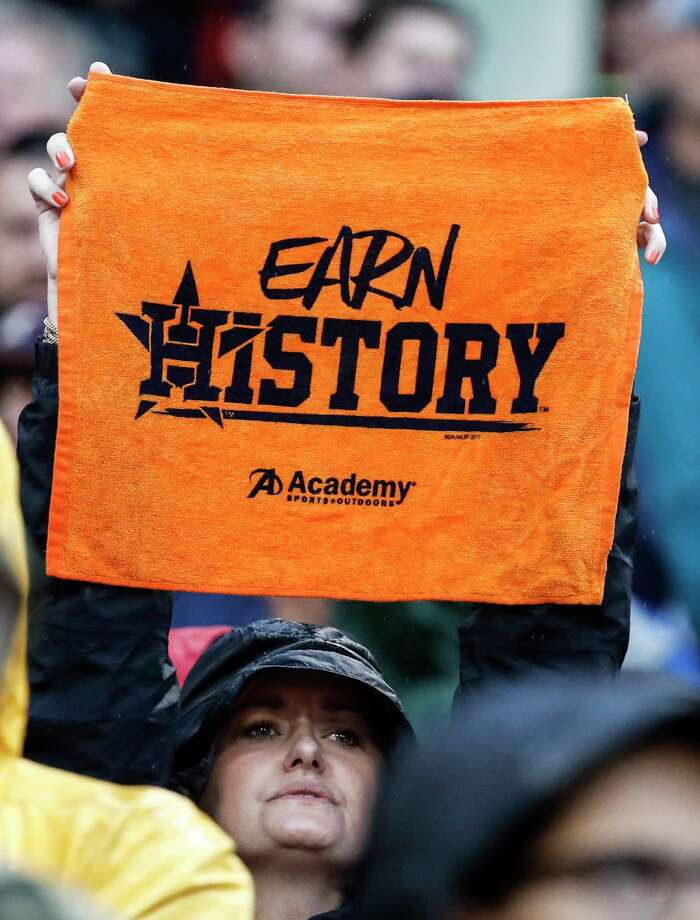 """A Houston Astros fan holds up an """"Earn History"""" towel during the ninth inning of Game 4 of the ALDS against the Boston Red Sox at Fenway Park on Monday, Oct. 9, 2017, in Boston. ( Karen Warren / Houston Chronicle ) Photo: Karen Warren, Staff / © 2017 Houston Chronicle"""