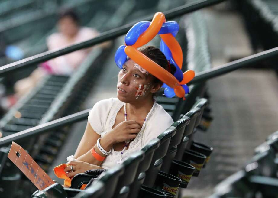 "Vanessa Sanchez watches the ALDS at Minute Maid Park, Friday, Oct. 9, 2017, in Houston. ""I've been watching the Astros for too many years,"" she said. ""It's good."" Photo: Jon Shapley, Staff Photographer / Houston Chronicle"