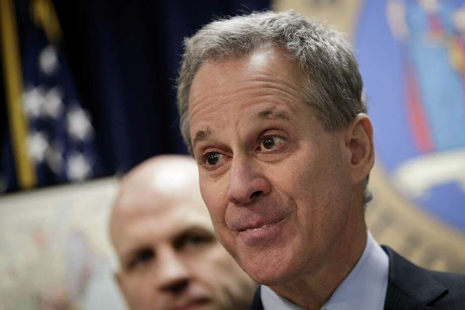 NEW YORK, NY - MARCH 15:  New York state Attorney General Eric Schneiderman speaks during a news conference to announce the take down of a large organized crime ring, March 15, 2017 in New York City. The investigation, dubbed Operation Sticky Fingers, has resulted in charges against 12 people accused of stealing more than $12 million in high-end electronics and supplies from retail stores and reselling the merchandise on Amazon and eBay. (Photo by Drew Angerer/Getty Images) ORG XMIT: 700020480 Photo: Drew Angerer / 2017 Getty Images