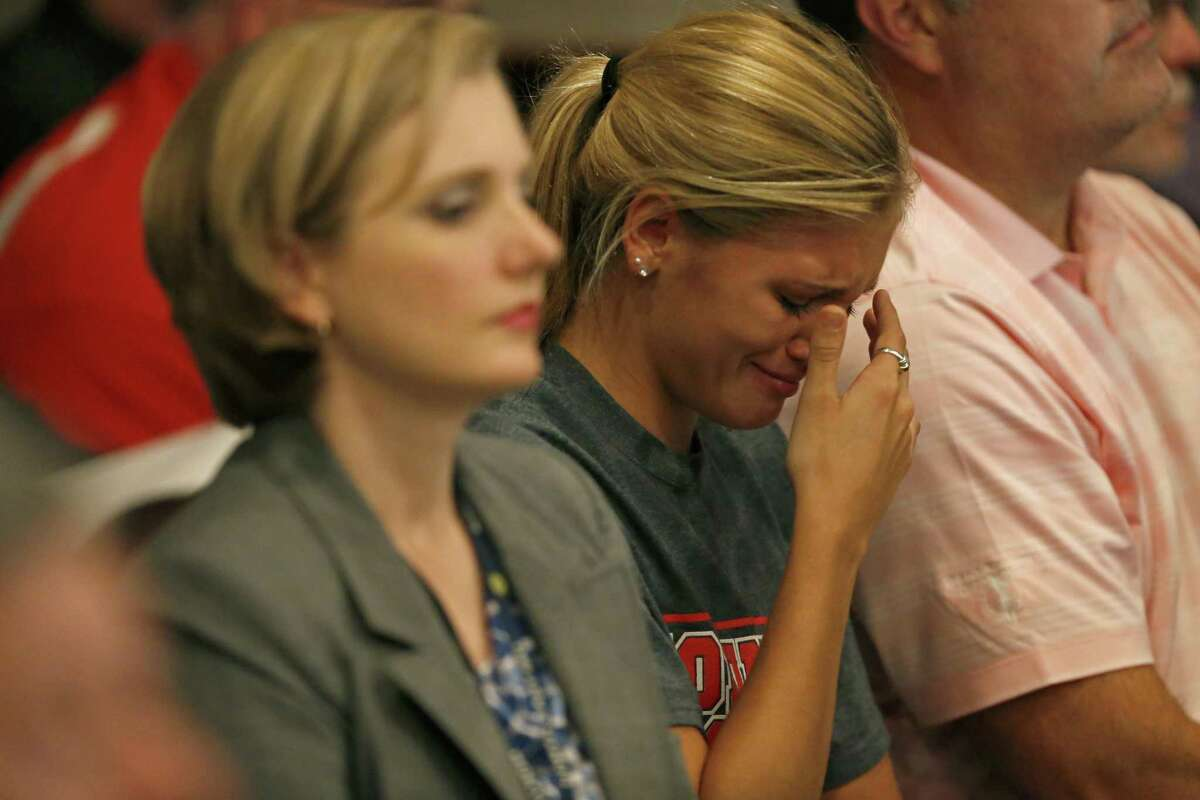 Lee High School senior Kendall Kloza cries during the board meeting Monday. The board voted to change the school's name to Legacy of Educational Excellence High School, or LEE High School. Hey, wait - the acronym spells the same word! What a coincidence!