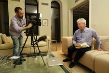 "In this photo provided by the University of Chicago, Richard Thaler gets ready for an interview with University of Chicago videographer Derek Henkle at Thaler's home in Chicago after winning the Nobel prize in economics, Monday, Oct. 9, 2017. The prize was awarded to Thaler of the University of Chicago for research showing how people's choices on economic matters, whether on savings or game shows like ""Deal or No Deal"", are not always rational. (Anne Ryan/University of Chicago via AP)"