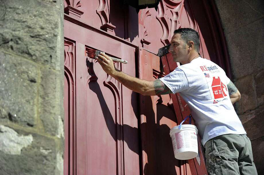 Kurt Sabbagh of Big Brush Painting, is  painting the front doors of St. James Episcopal Church in Danbury, as part of celebration of his 20th anniversary in business. Photo Friday, Oct. 6, 2017. Photo: Carol Kaliff / Hearst Connecticut Media / The News-Times