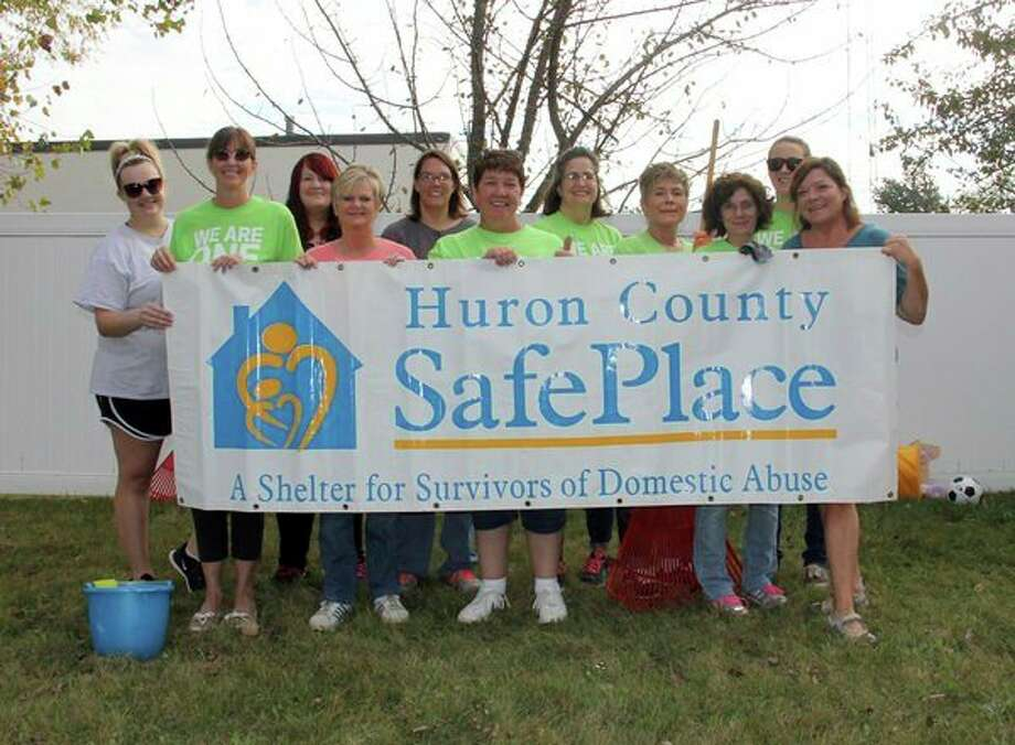 Members of the Bad Axe Chemical Bank branch spent a good portion of Monday cleaning, painting and doing everything in between at the Huron County SafePlace as part of the bank's annual Care Day. (Bradley Massman/Huron Daily Tribune)