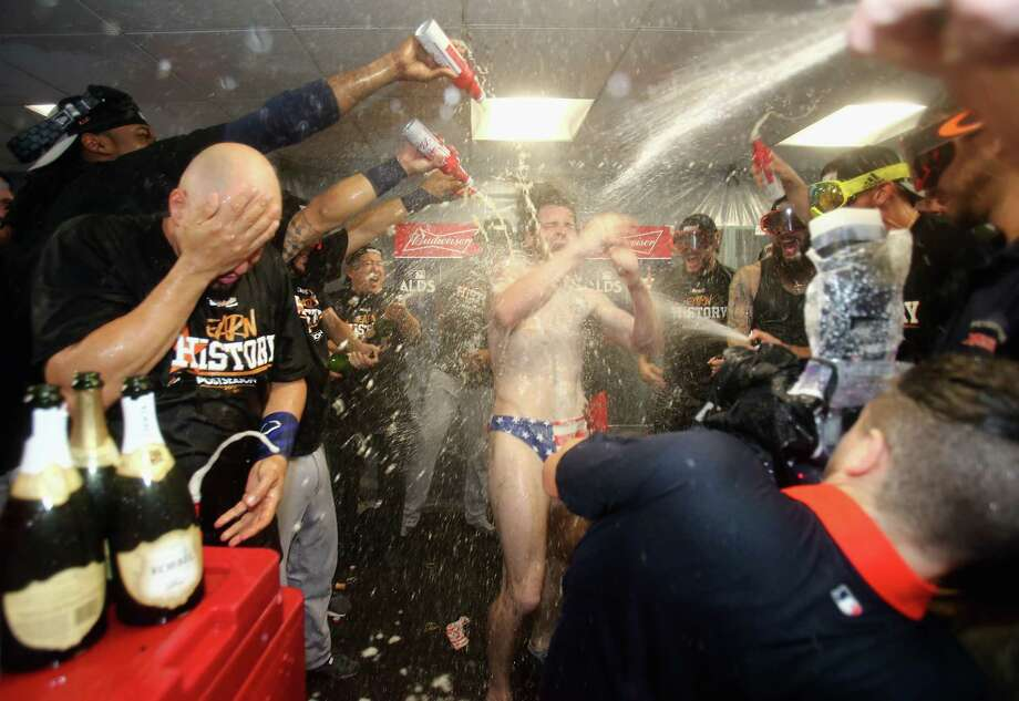 PHOTOS: Josh Reddick celebrates in his American flag SpeedoBOSTON, MA - OCTOBER 09:  Josh Reddick #22 of the Houston Astros celebrates with teammates in the clubhouse after defeating the Boston Red Sox 5-4 in game four of the American League Division Series at Fenway Park on October 9, 2017 in Boston, Massachusetts. The Astros advance to the American League Championship Series.Browse through the photos - if you dare - to see more of Josh Reddick and his celebratory Speedo. Photo: Elsa, Getty Images / 2017 Getty Images