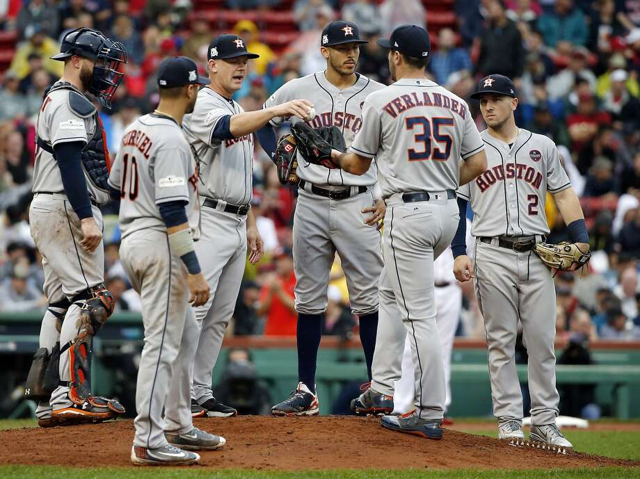 Houston Astros manager A.J. Hinch, third from left, gives the ball to pitcher Justin Verlander (35) for his very first Major League relief appearance during the fifth inning in Game 4 of baseball's American League Division Series against the Boston Red Sox, Monday, Oct. 9, 2017, in Boston. (AP Photo/Michael Dwyer) Photo: Michael Dwyer, Associated Press